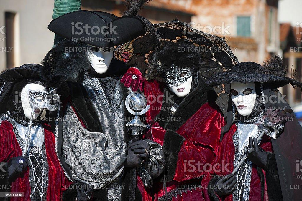 Four Masks Posing 2013 Carnival Venice Italy royalty-free stock photo