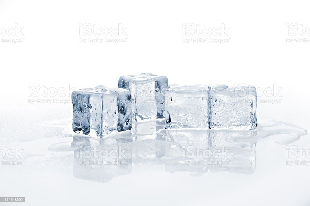 Four melting ice cubes in a row stock photo