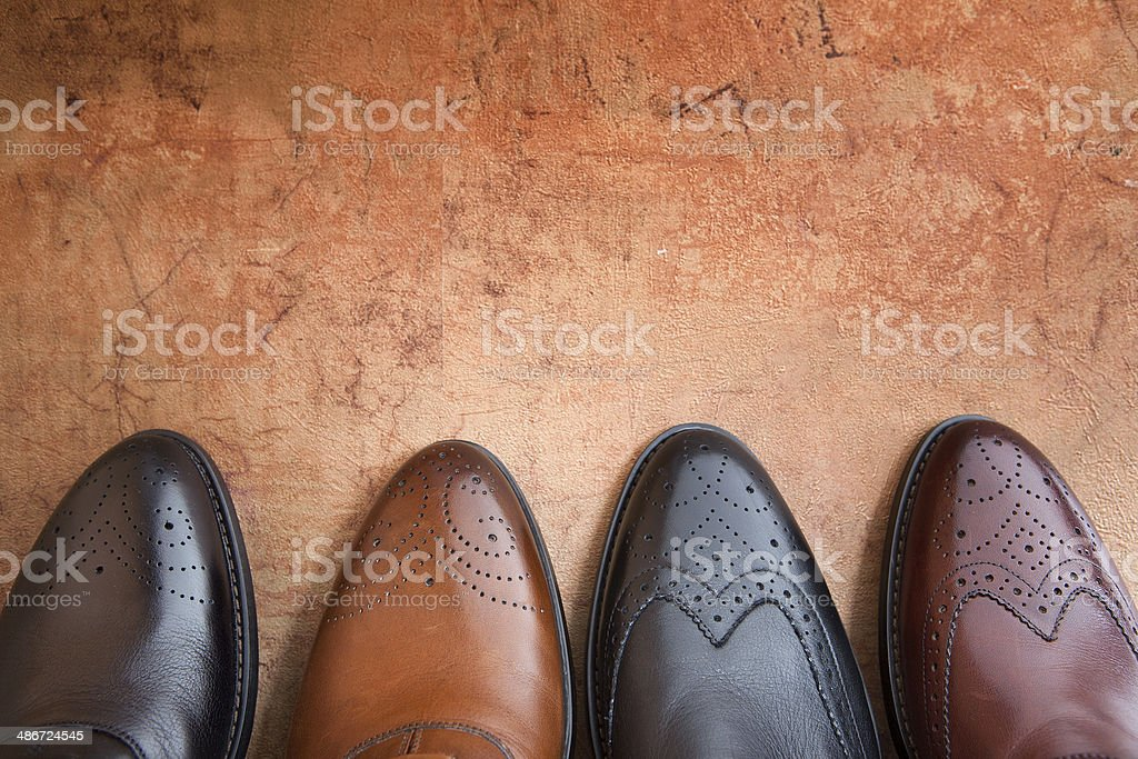 four men shoe stock photo