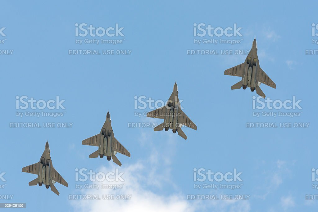 Four military aircraft MiG-29 flying over the Red Square stock photo