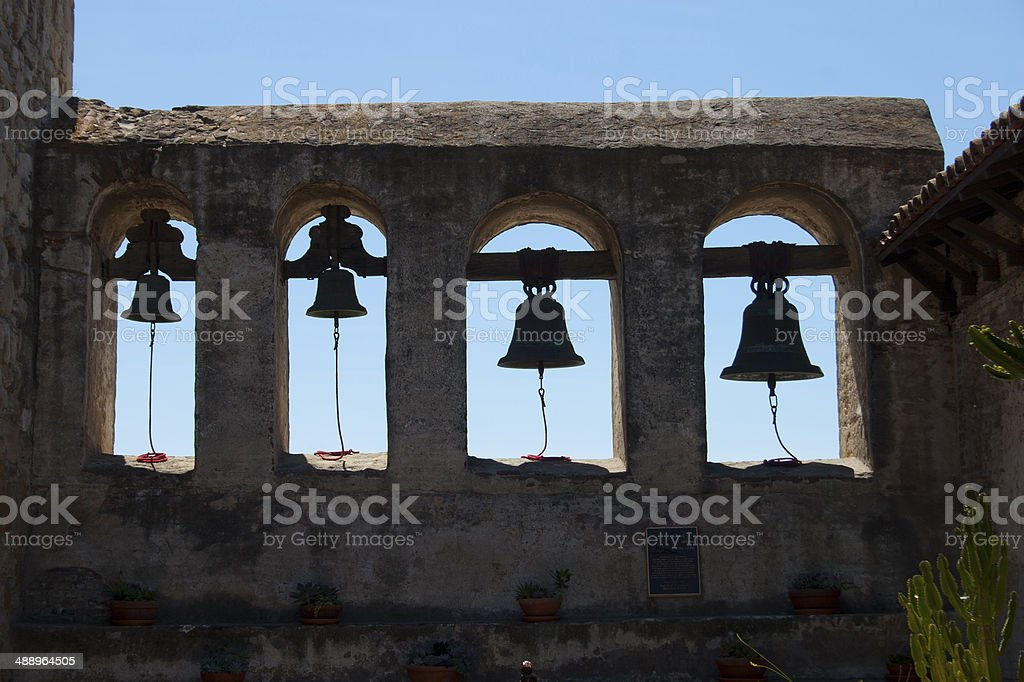 four mission bells at the mission stock photo