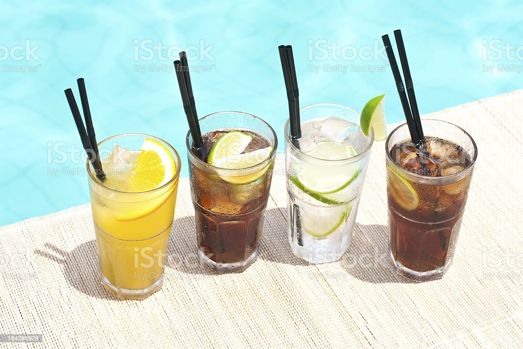 Four mix drink popular cocktail near waterpool royalty-free stock photo