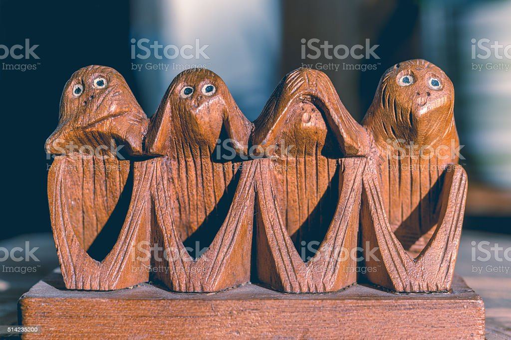 Four monkeys hear, see, speak and do no evil stock photo