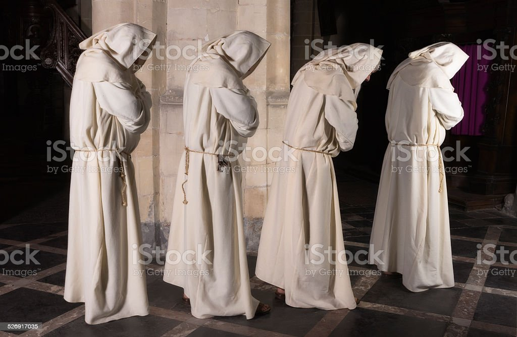 Four monks in a row stock photo