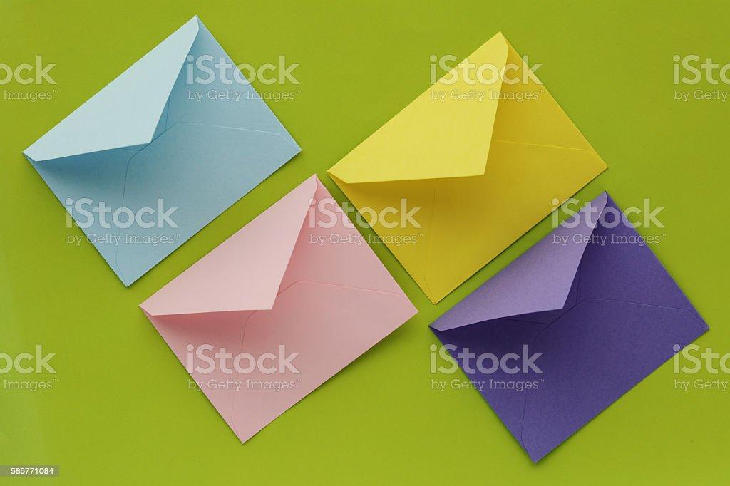 Four multi-coloured envelopes stock photo