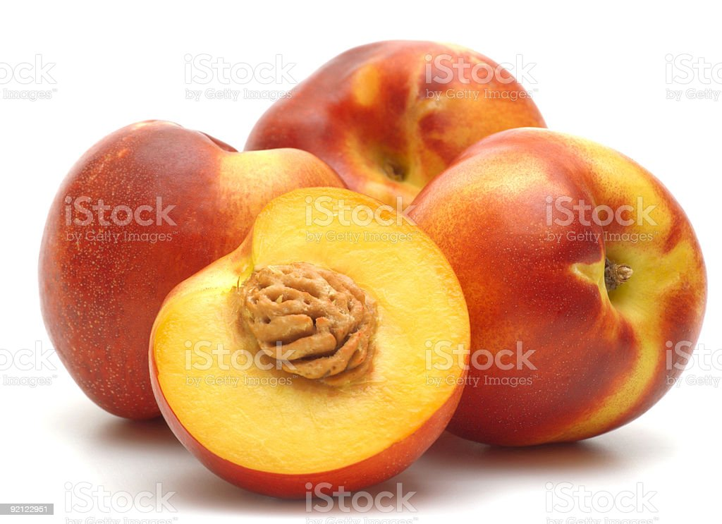 Four nectarine whole and halves on white stock photo