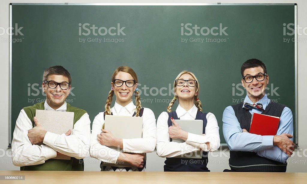 Four nerds holding books royalty-free stock photo