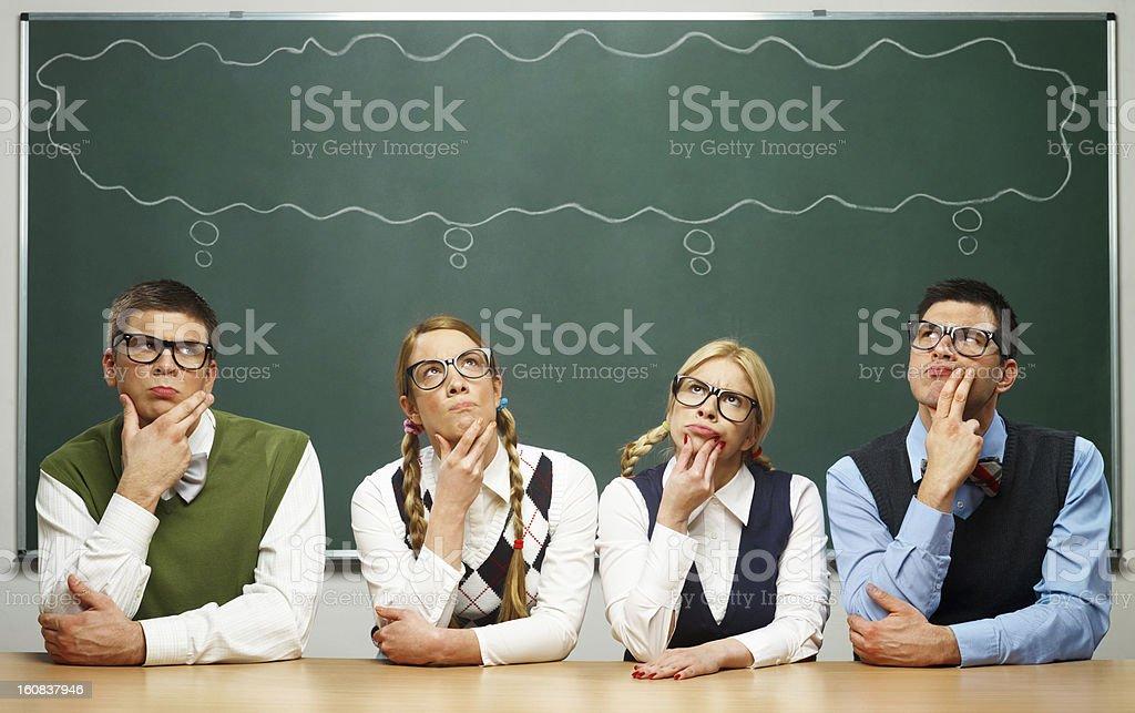 Four nerds thinking royalty-free stock photo