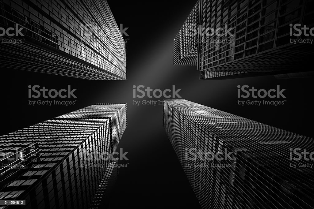Four New York skyscrapers converging towards the sky stock photo