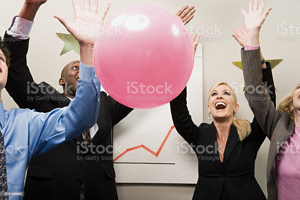 Four office workers celebrating stock photo