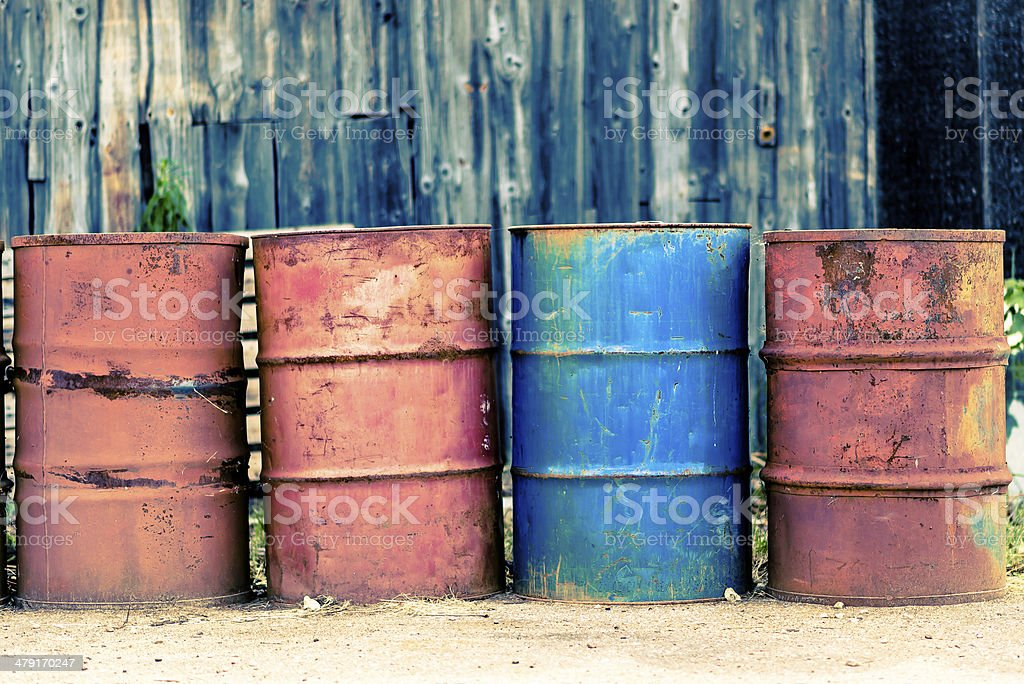 Four old barrels for oil, petroleum, red and blue. stock photo