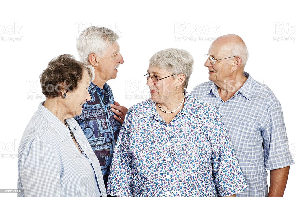 Four old people in animated discussion against white background royalty-free stock photo
