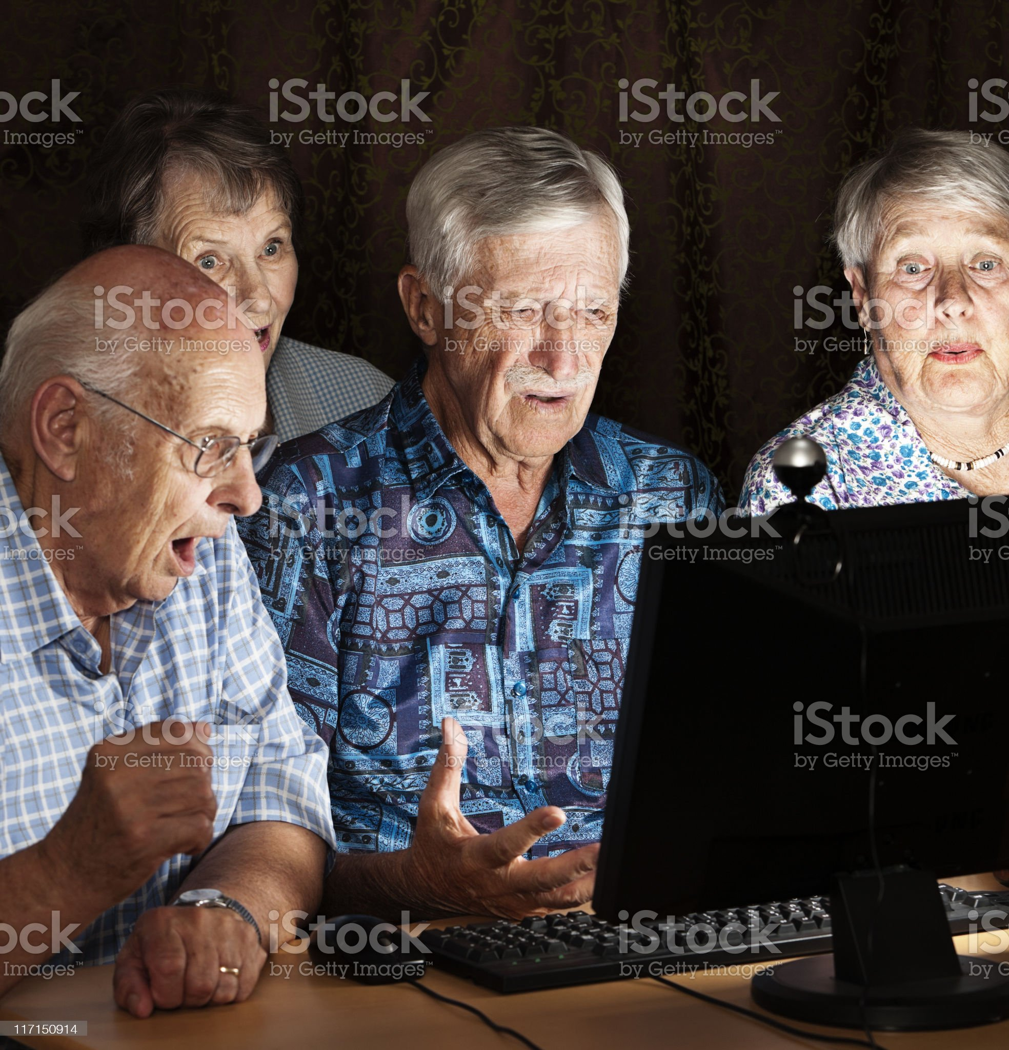 Four old people shocked by image on a computer monitor royalty-free stock photo