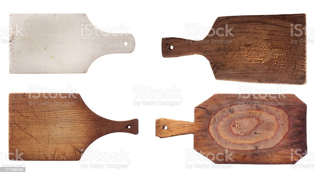 four old used chopping kitchen boards, isolated over white royalty-free stock photo