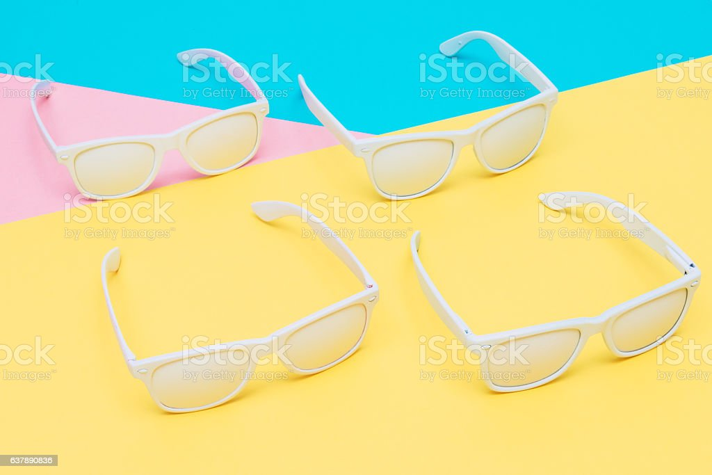 four open white sunglasses stock photo