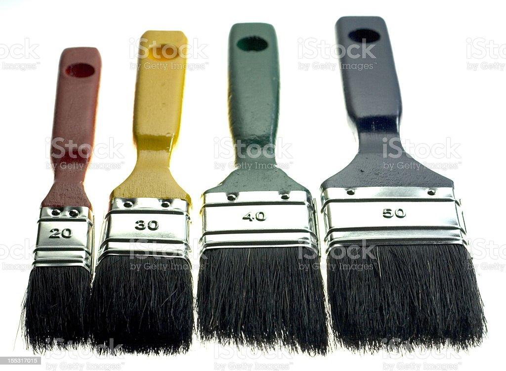 four paintbrushes stock photo