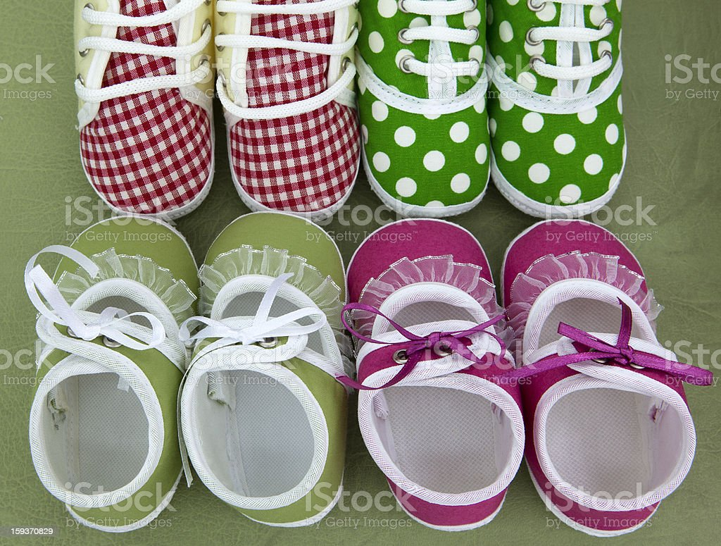 Four pair of baby shoes. stock photo