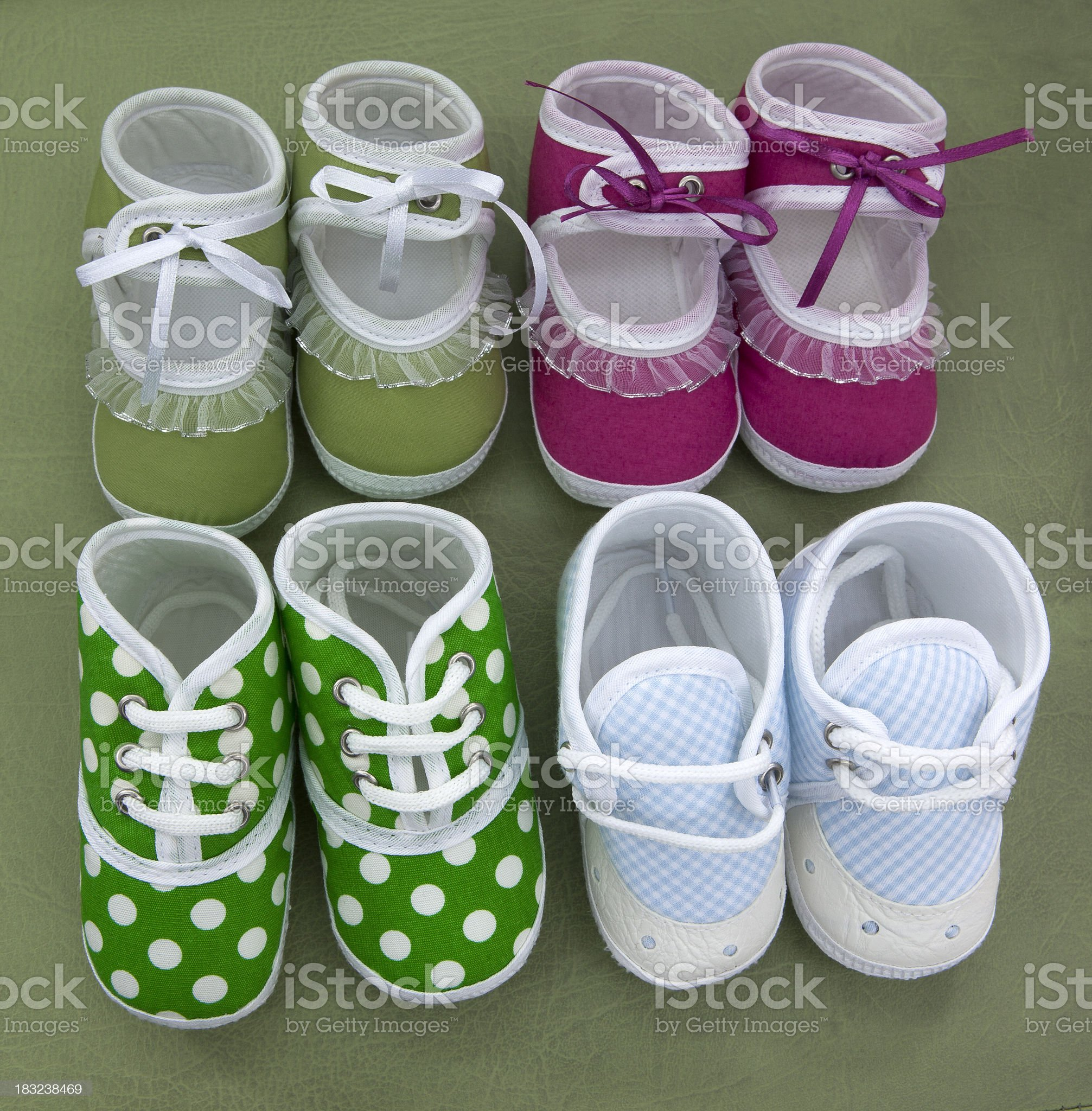 Four pair of baby shoes. royalty-free stock photo