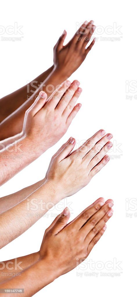 Four pairs of isolated hands praying against white royalty-free stock photo