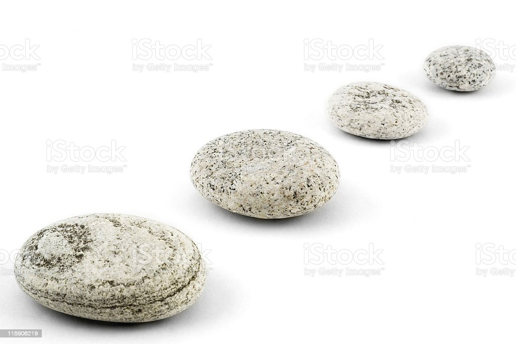 Four pebbles diagonal, wide focus stock photo