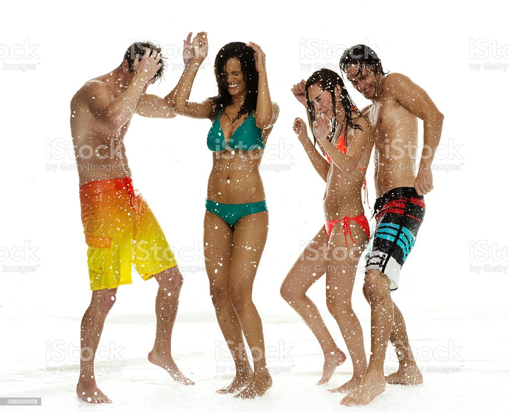 Four people dancing in the rain stock photo