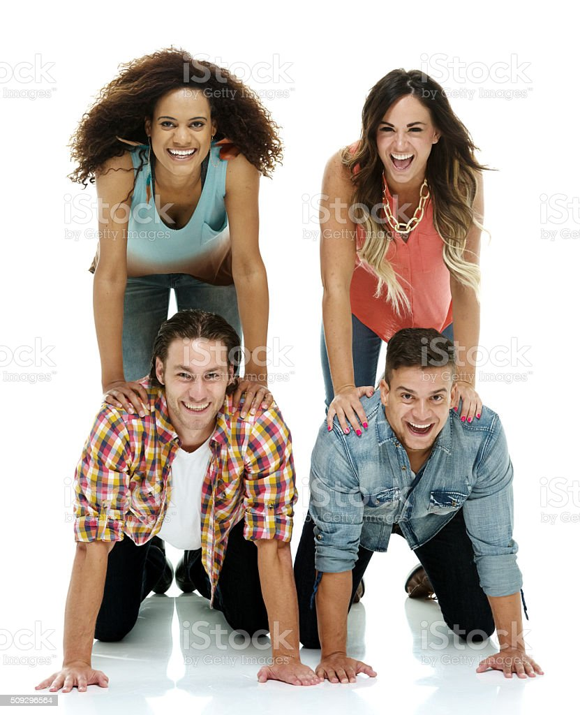 Four people doing a human pyramid stock photo