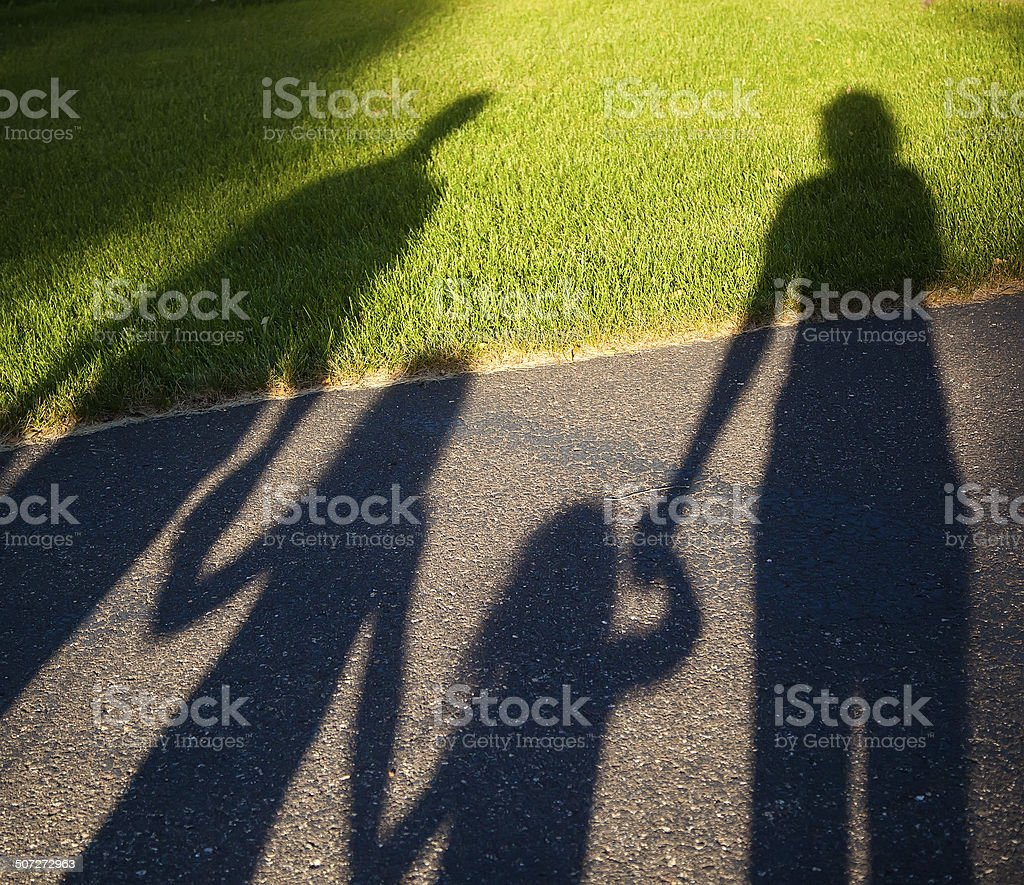Four People Holding Hands Shadow Family stock photo