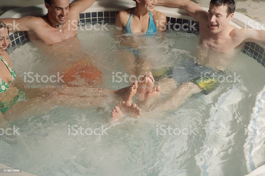 Four people in jacuzzi stock photo