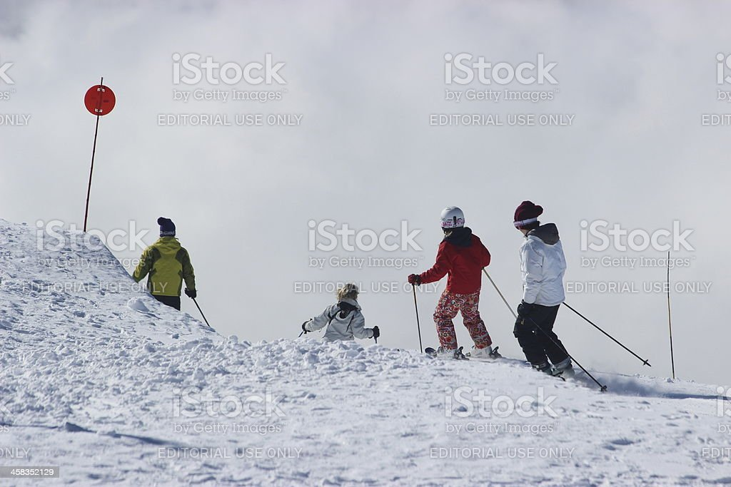 Four people skiing at ski station CERRO CATEDRAL stock photo