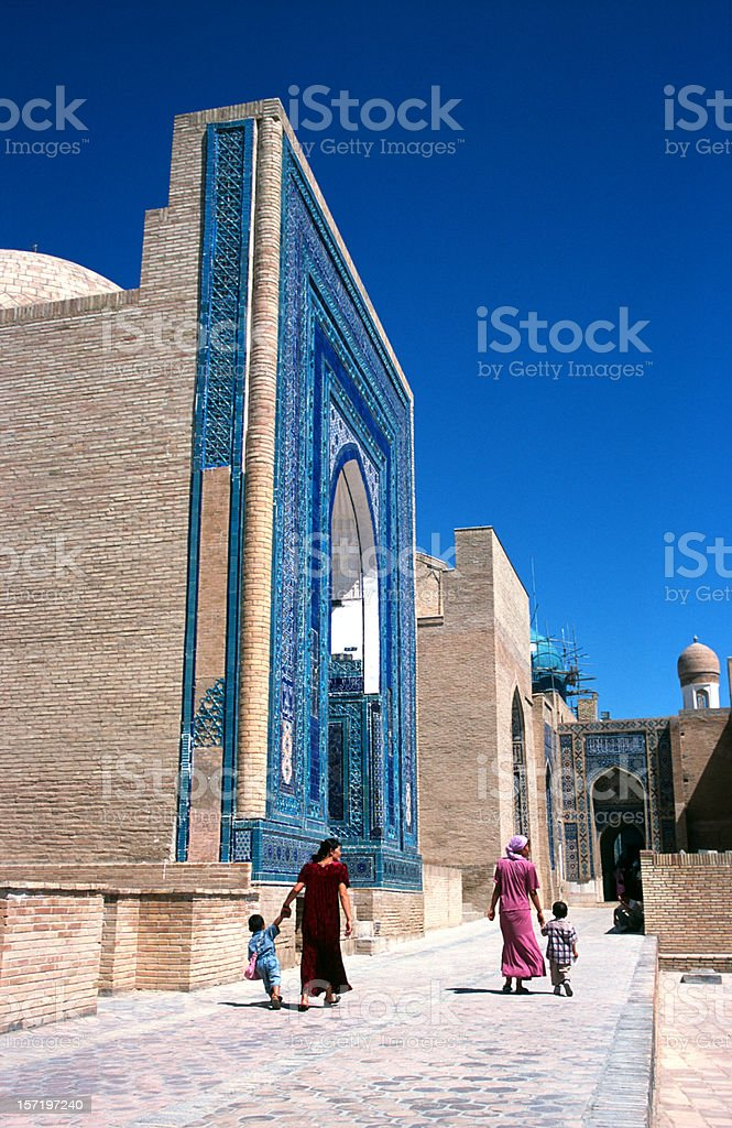 Four people walking at Mausoleum stock photo