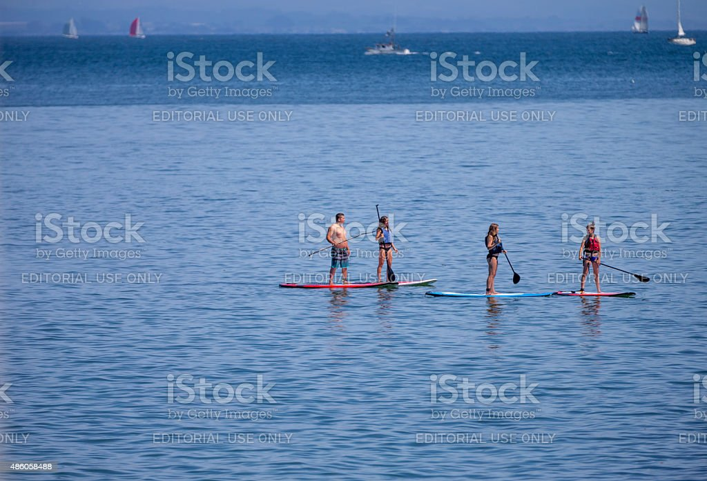 Four peoples playing paddle board at Santa Cruz of California stock photo