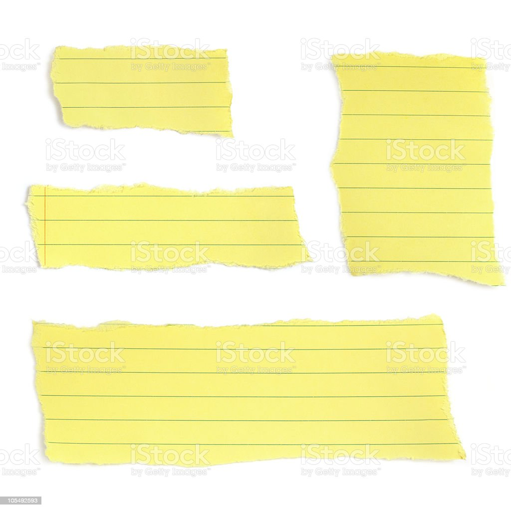 Four pieces of torn yellow lined paper stock photo