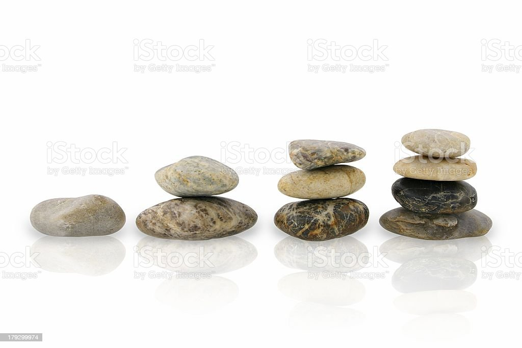 Four piles of pebbles stock photo