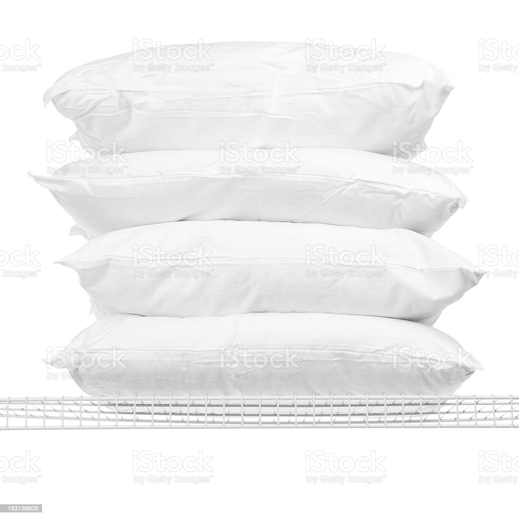 Four Pillows on Shelf stock photo