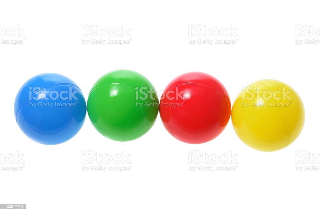 Four plastic colored balls in s row stock photo