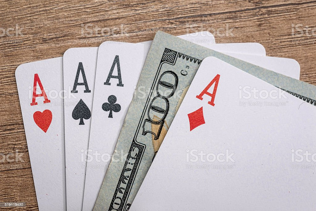 four poker aces with 100 dollar bills stock photo