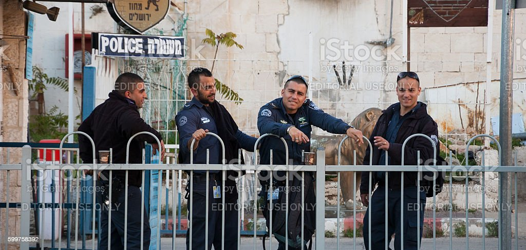 Four police officers have coffee break at police station court. stock photo