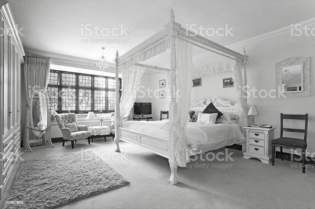 four poster bed in black and white royalty-free stock photo