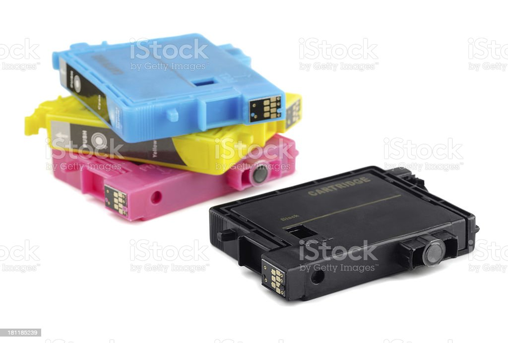 Four printer ink cartridges in black, yellow, blue and pink stock photo
