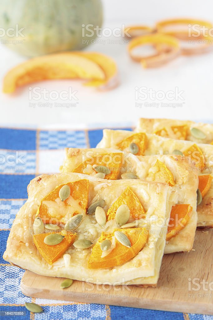 Four puff pastries with pumpkin, garlic and cheese royalty-free stock photo