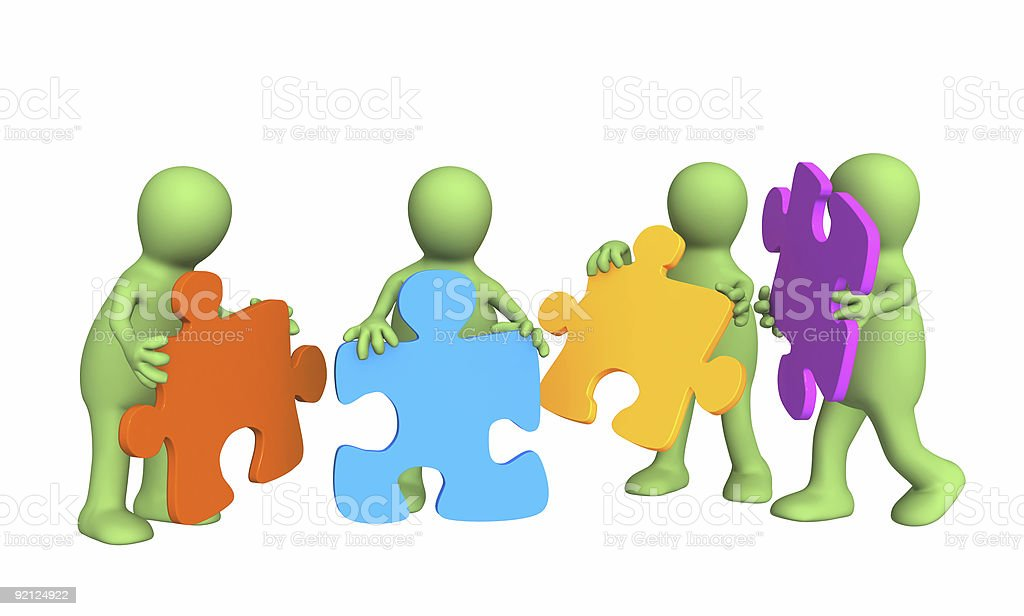 Four puppets, holding in hands a puzzle royalty-free stock photo