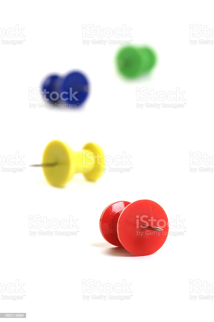 Four push pins on white background with selective focus royalty-free stock photo