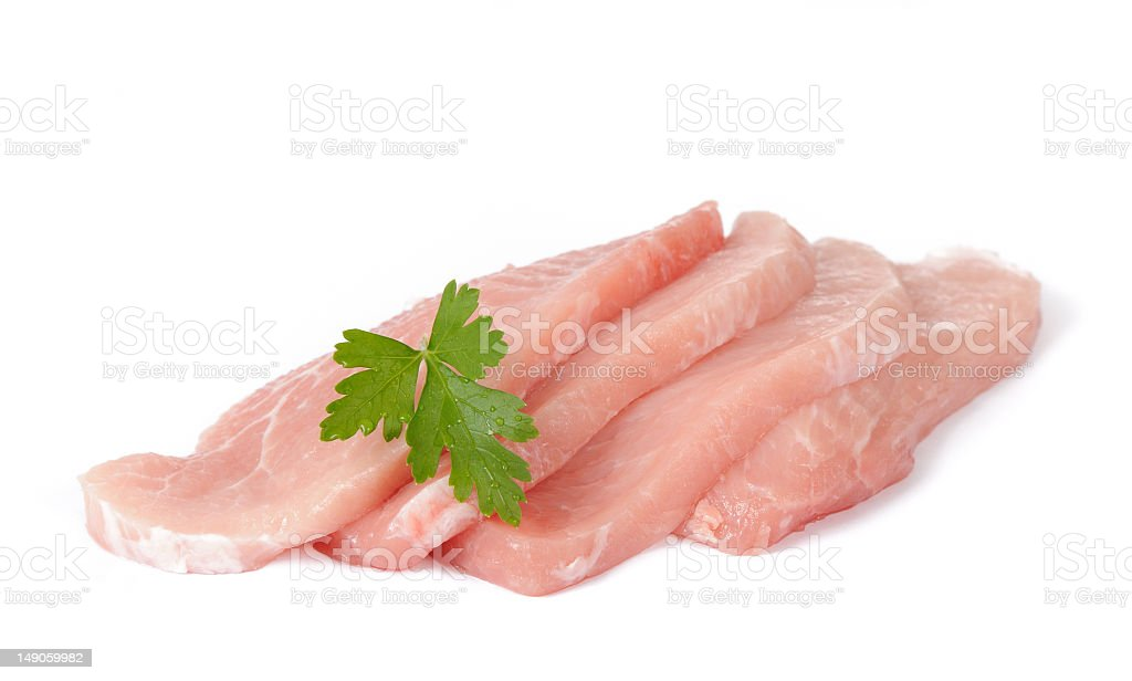 Four raw slices of pork meat on white background stock photo