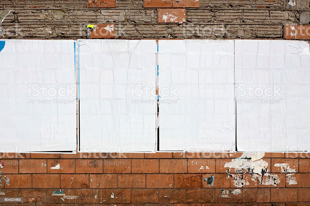 Four real blank billboards on a dilapidated wall stock photo