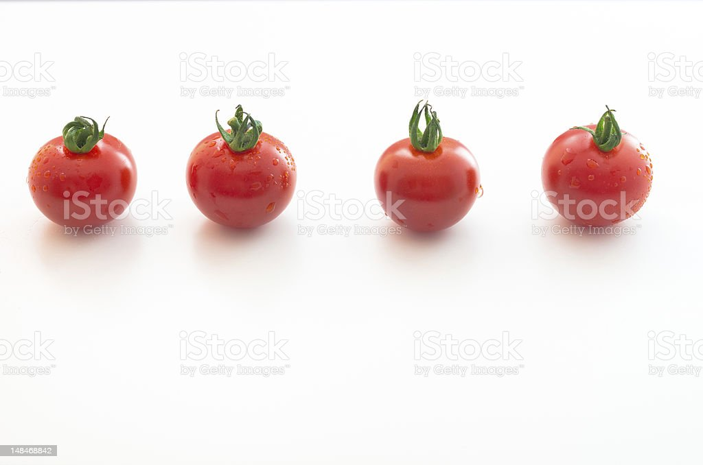 Four Red Cherry Tomatoes in a Row royalty-free stock photo