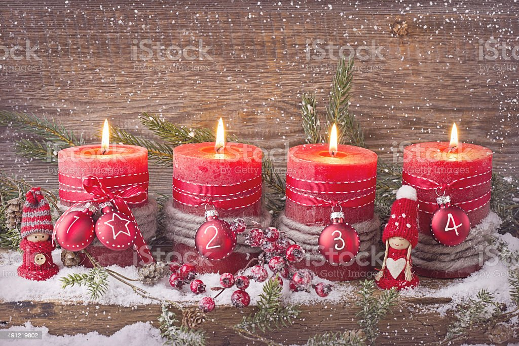 Four red christmas candle stock photo