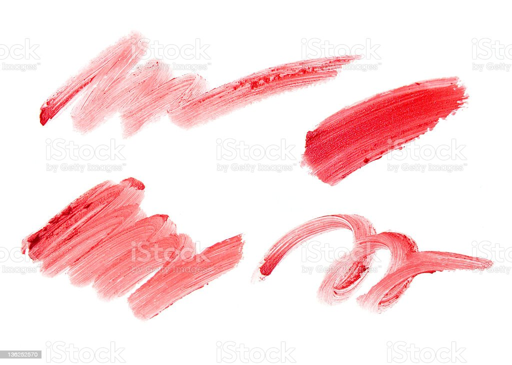 Four red lipstick smears on a white background royalty-free stock photo