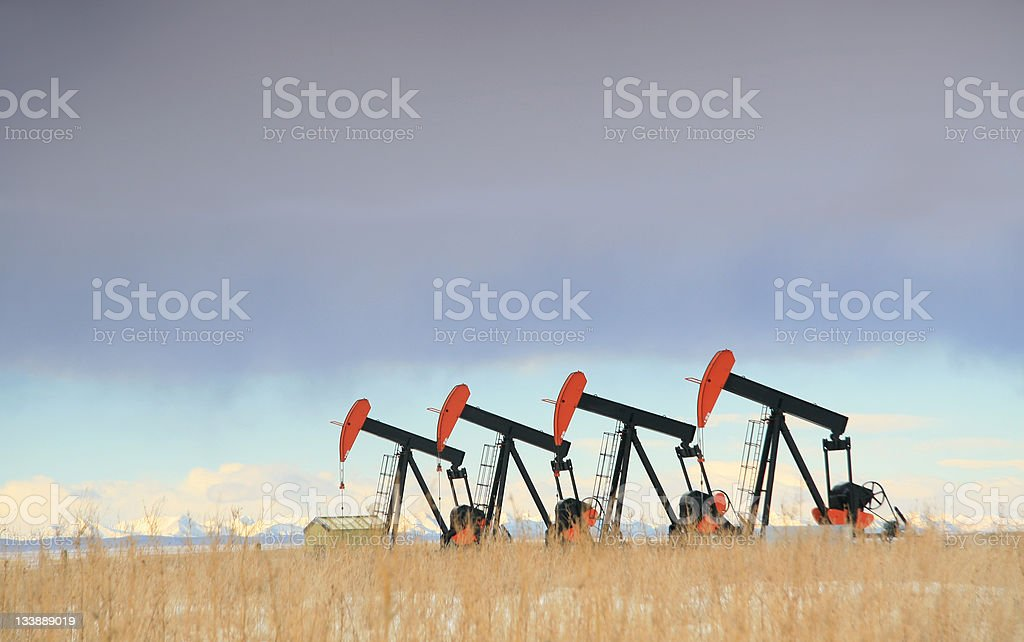 Four Red Oil Field Pumpjacks in Alberta royalty-free stock photo