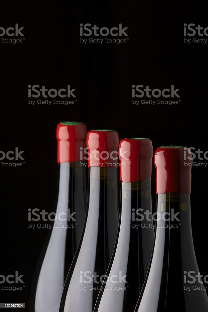 Four Red wine bottles royalty-free stock photo