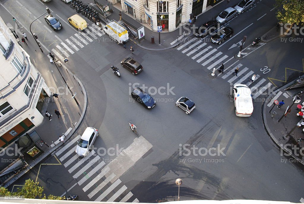 Four road junction with cars in Paris stock photo